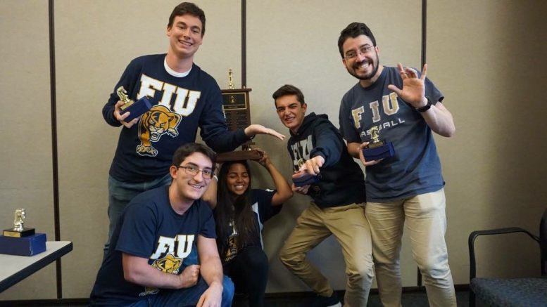 9636fcc3da The FIU Chess Club winning first place in the 2018 Florida Intercollegiate  Spring Chess Classics in Orlando, FL.